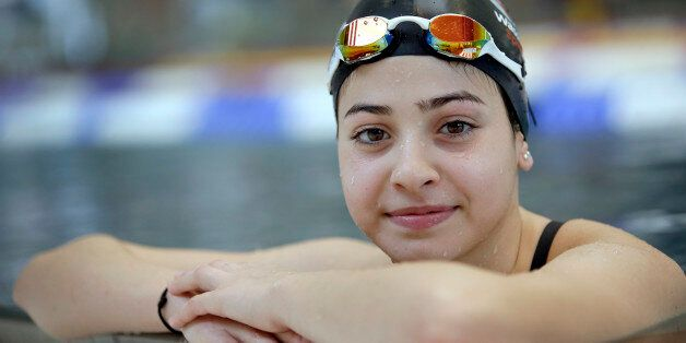 FILE - This is a Monday, Nov. 9, 2015 file photo of Yusra Mardini from Syria poses during a training...