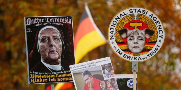 Supporters of the right-wing Alternative for Germany (AfD) demonstrate against the German government's...