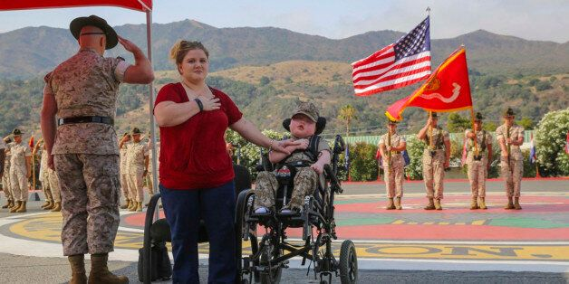 Wyatt Gillette, 8, front right, visits Camp Pendleton, Calif., Saturday, July 30, 2016, with his mother...