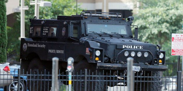 A Homeland Security tactical vehicle sits in the crime scene area of Thursday night shooting, Sunday,...