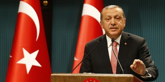 Turkish President Tayyip Erdogan speaks during a news conference following the National Security Council...