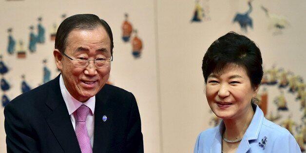 UN Secretary-General Ban Ki-moon (L) shakes hands with South Korean President Park Geun-Hye during a...