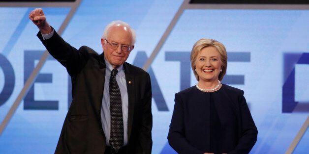 Democratic U.S. presidential candidates Senator Bernie Sanders and Hillary Clinton pose before the start...