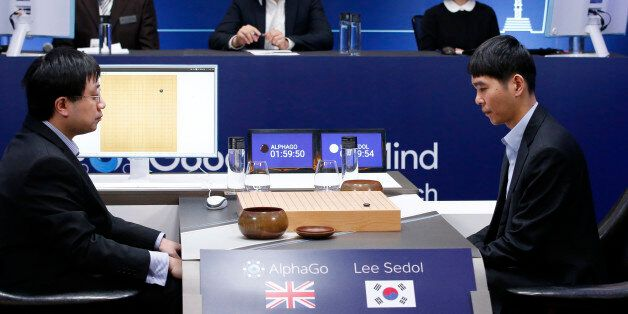 South Korean professional Go player Lee Sedol, right, prepares for his first stone against Google's artificial...