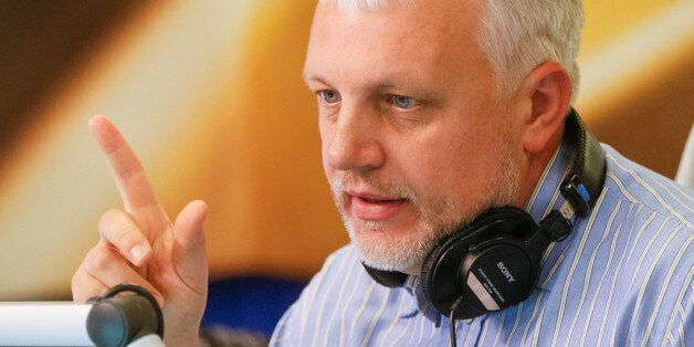 Journalist Pavel Sheremet talks on the air at a radio station in Kiev, Ukraine, October 11, 2015. Picture...