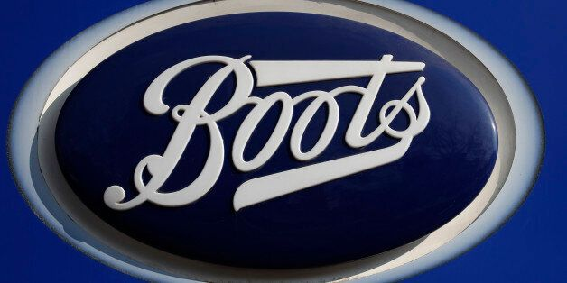 A company logo is pictured outside a branch of Boots the chemists in Manchester northern England, March...