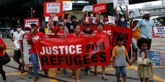 Refugees and their supporters protest to mark World Refugee Day in Hong Kong, China June 20, 2016. REUTERS/Bobby