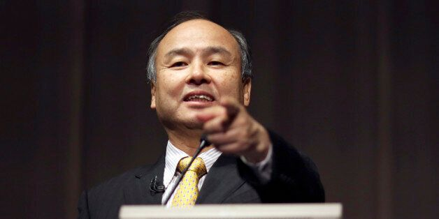 FILE - In this Nov. 4, 2014 file photo, SoftBank founder and Chief Executive Officer Masayoshi Son speaks...