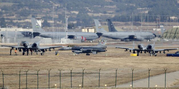 A Turkish Air Force F-16 fighter jet ( C foreground) is seen between U.S. Air Force A-10 Thunderbolt...