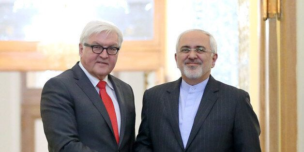 Iranian Foreign Minister Mohammad Javad Zarif, right, and his German counterpart Frank-Walter Steinmeier...