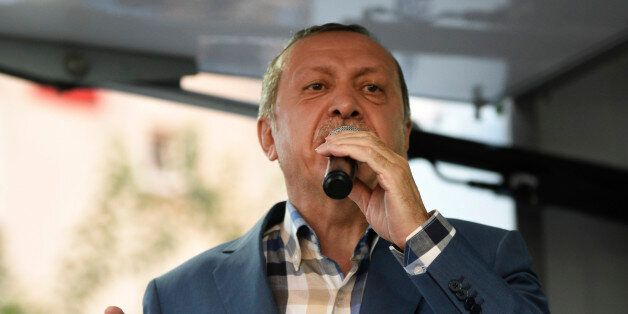 Turkish President Recep Tayyip Erdogan delivers a speech in Istanbul, Saturday, July 16, 2016. Forces...
