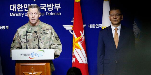 Lt. Gen. Thomas Vandal, the commander of U.S. Forces Korea's Eighth Army, center, speaks to the media...