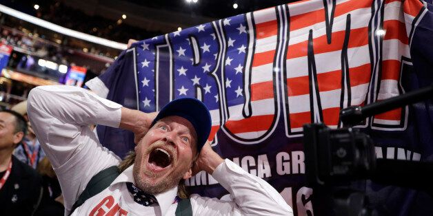 California delegate Jake Byrd reacts as New York delegate Bob Hayssen holds up a Trump flag during the...