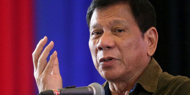 Philippine President-elect Rodrigo Duterte speaks during a conference with businessmen in Davao city,...