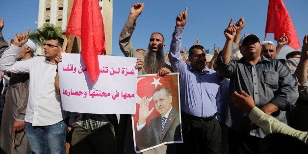 Palestinians take part in a Hamas a rally in support of Turkish President Tayyip Erdogan's government...