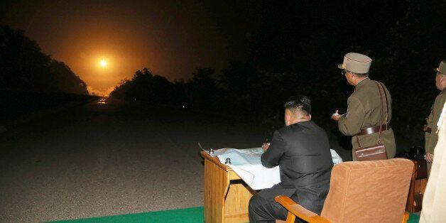 North Korean leader Kim Jong Un provides field guidance during a tactical rocket firing drill carried...