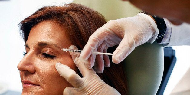 Carolyn Landis, of Roslyn, receives botox treatment from Dr. Kaveh Alizadeh at the Long Island Plastic...