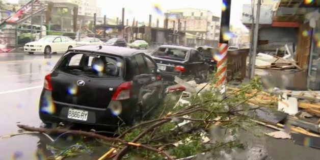 In this image made from video, wind-blown debris from Typhoon Nepartak litters the street and damages...