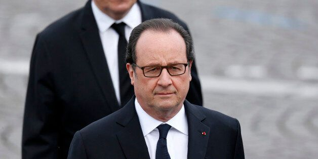 French President Francois Hollande and French Defence Minister Jean-Yves Le Drian attend the Bastille...