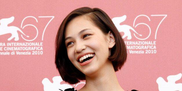 Japanese actress Kiko Mizuhara poses for photographers during a photocall