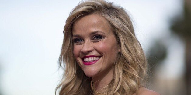 Cast member Reese Witherspoon poses at the premiere