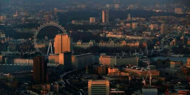 The early morning sun lights buildings in an aerial photograph from The View gallery at the Shard, western...