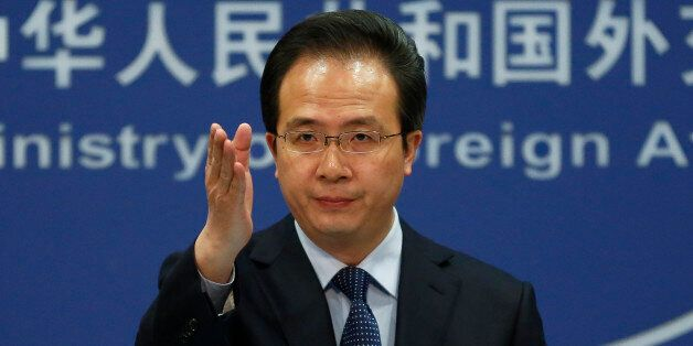 China's Foreign Ministry spokesman Hong Lei gestures during a daily briefing at the Ministry of Foreign...