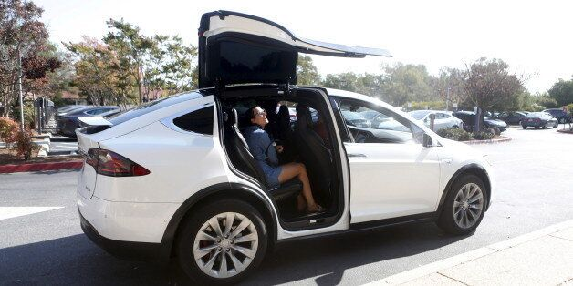 A Tesla Model X picks up passengers during a Tesla event in Palo Alto, California October 14, 2015. REUTERS/Beck