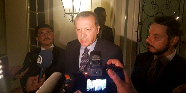 Turkish President Tayyip Erdogan speaks to media in the resort town of Marmaris, Turkey, July 15, 2016....