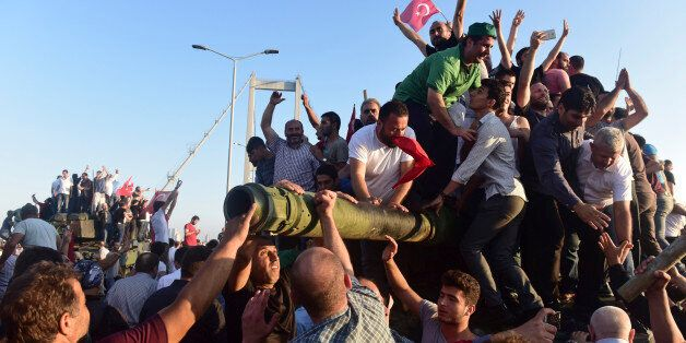 Supporters of Tukish President Tayyip Erdogan celebrate after soldiers involved in the coup surrendered...