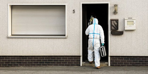 FILE - In this Nov. 13, 2015 file picture a police investigator in protective cloth enters a house in...