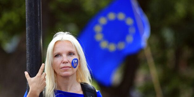 A woman stands still during a 'March for Europe' demonstration against Britain's decision to leave the...