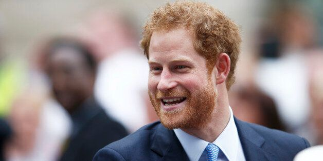 Britain's Prince Harry greets guests on the Mall as they attend the Patron's Lunch, an event to mark...