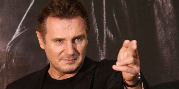 Actor Liam Neeson poses before a news conference to promote his