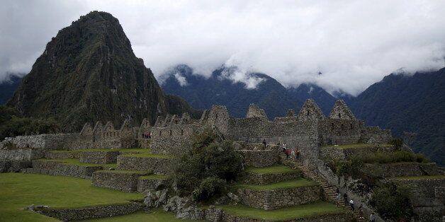 Visitors walk at the Inca citadel of Machu Picchu in Cusco, Peru, August 12, 2015. Machu Picchu, a UNESCO...