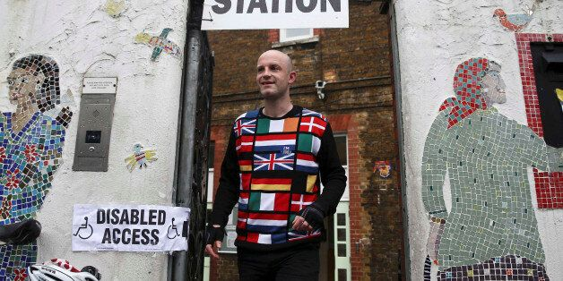 A man wearing a European themed cycling jersey leaves after voting at a polling station for the Referendum...