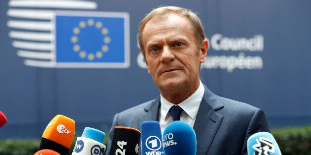 European Council President Donald Tusk talks to the media as he arrives at the EU Summit in Brussels,...