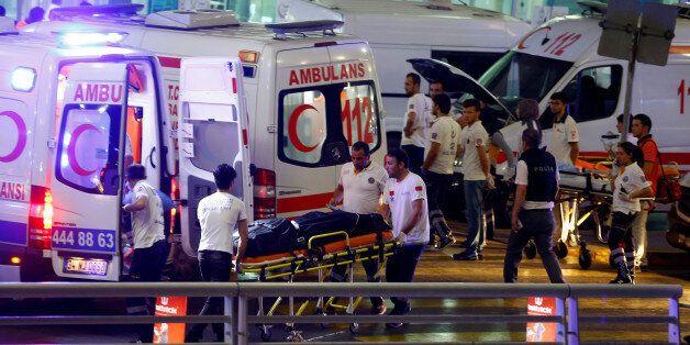 Ambulances arrive at Turkey's largest airport, Istanbul Ataturk, Turkey, following a blast June 28, 2016....