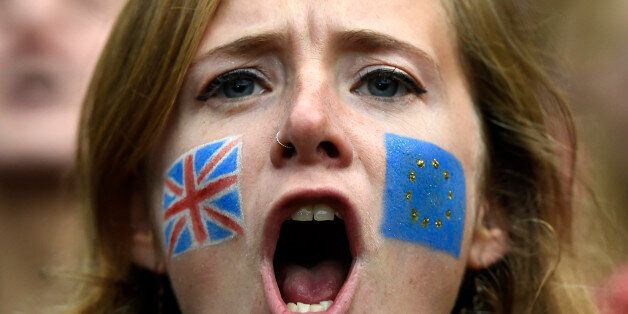 Demonstrators shout outside the Houses of Parliament during a protest aimed at showing London's solidarity...