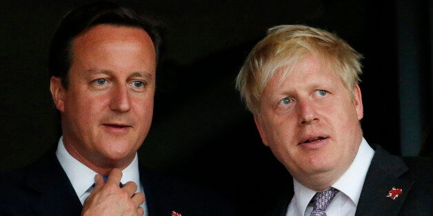 FILE - This is a Friday, July 27, 2012 file photo of Britain's Prime Minister David Cameron, left, and...