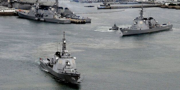 Japan Maritime Self-Defense Force's (JMSDF) Aegis destroyers Myoko (L) and Kongo sail off from the JMSDF...