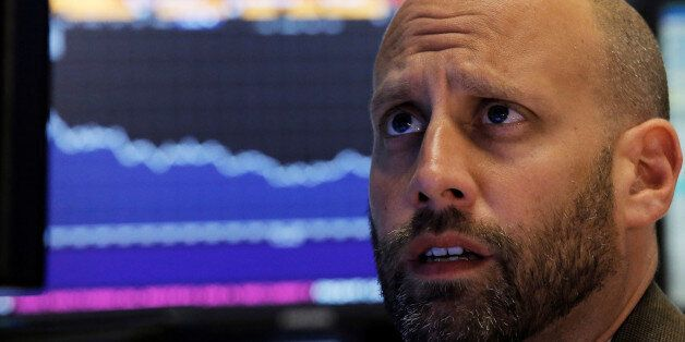A specialist trader works at his post on the floor of the New York Stock Exchange (NYSE) in New York...