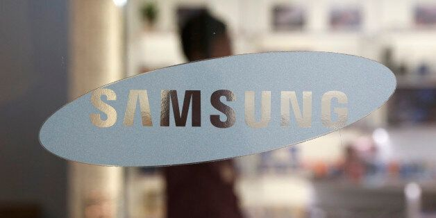 In this Oct. 29, 2015 photo, a logo of Samsung Electronics Co. is seen at its shop in Seoul, South Korea....