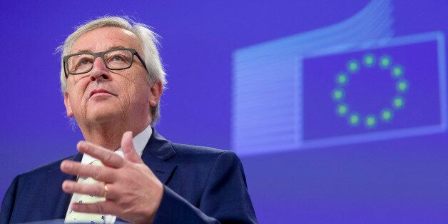 European Commission President Jean-Claude Juncker prepares to address a media conference at EU headquarters...