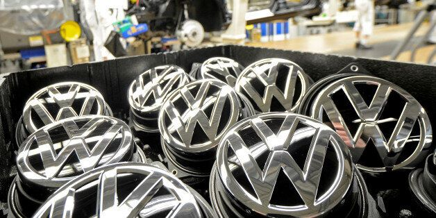 Emblems of VW Golf VII car are pictured in a production line at the plant of German carmaker Volkswagen...