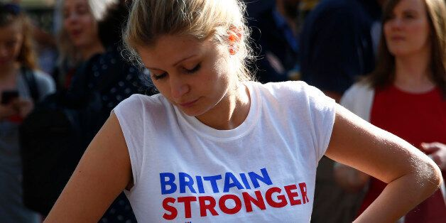 A woman wearing a vote remain tee-shirt reacts, following the result of the EU referendum, in London,...
