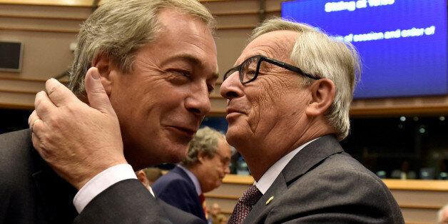 European Commission President Jean-Claude Juncker welcomes Nigel Farage, the leader of the United Kingdom...