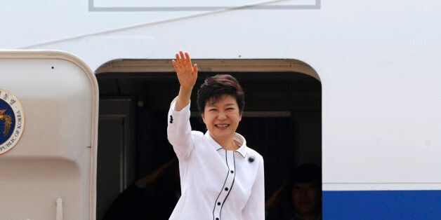 South Korean President Park Geun-hye waves as she embarks an airplane at the Seoul Air Base of South...