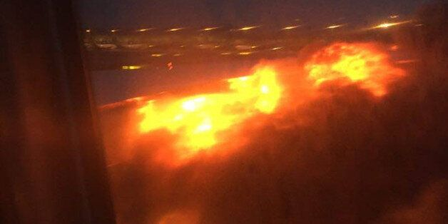 This image provided by Lee Bee Yee shows an engine on fire on a Singapore Airlines flight on Monday,...