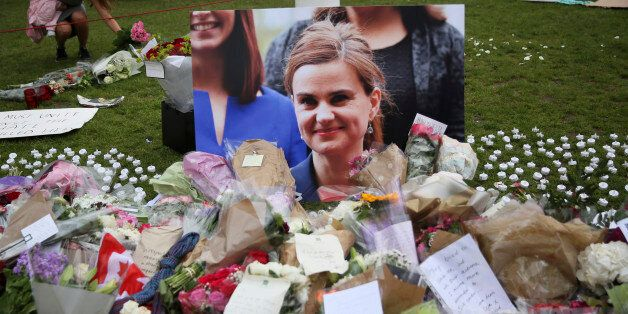 Tributes in memory of murdered Labour Party MP Jo Cox, who was shot dead in Birstall, are left at Parliament...
